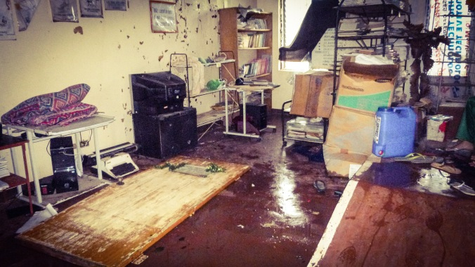 The office which was destroyed after winds blew unexpectedly from the west. The door of the office, which blew off its hinges, lies on the ground.