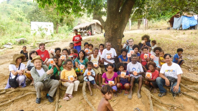 Arriving at the Aeta community. The small orange objects everybody holds are the solar-panel lights which are saving the community a lot each year!